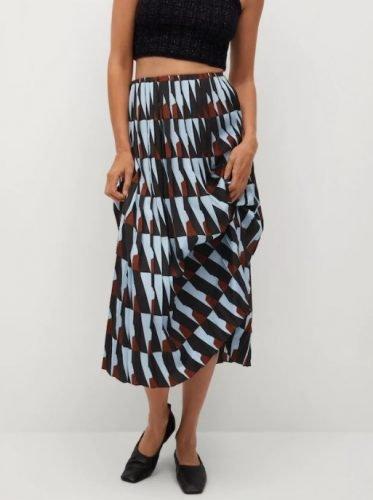 Cómo combinar tus faldas plisadas en tus looks de invierno foto 11