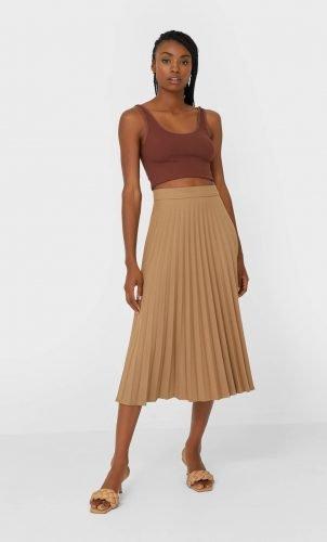 Cómo combinar tus faldas plisadas en tus looks de invierno 13