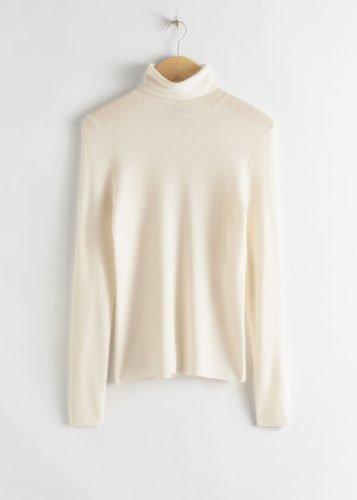 Cómo combinar jerséis de cuello alto como las influencers foto7